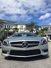 2013 Mercedes-Benz SL-Class SL63 AMG Immaculate 2013 Mercedes SL63 Silver Arrow silver with Red leather. 13,425 miles