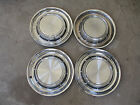 1957 PONTIAC HUB CAPS GOOD CONDITION SET OF FOUR PLEASE LOOK AT PHOTOS