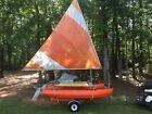 vintage catyak sailboat and trailer
