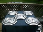 "Vintage early 1960's Oldsmobile 14"" hubcaps set of 5"