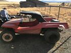 70's dune buggy body with VW chassis, dual port engine & transmission.