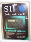 VINTAGE NEW SEIKO INSTRUMENTS AUTOMOBILE ORGANIZER! CALCULATOR/METRIC CONVERTER!