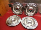 """4 NOS 60 GM Oldsmobile 16"""" Wheelcovers #580894"""