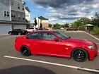 2009 BMW 3-Series 335xi bmw 335 xDrive red with manual transmission and lots of extras
