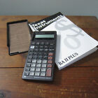 Texas Instruments BA II Plus financial analysis calculator with manual works