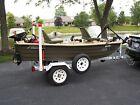 Sundolphin Pro 102 Boat, Motor, Trailer and Accessories