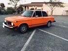 1974 BMW 2002  1974 BMW 2002; 4sp, Inka Orange/Black interior, no sunroof, all stock, 186k,