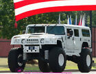 """2000 Hummer H1  Lifted Hummer H1 2000 with huge lift, 46"""" tires rolling on American Force wheels"""