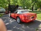 1989 Chevrolet Corvette  1989 RED CORVETTE WITH CONVERTIBLE WHITE TOP AND RED HARD TOP
