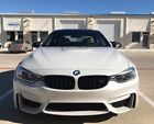 2015 BMW M4 Mineral White Exterior, Tan/Black/Carbon Fiber Int Mineral White 2015 BMW M4 w/ Carbon Fiber; 3.0L Twin-Turbo; 0-60 in 3.9 Seconds