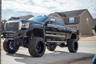 "2017 GMC Sierra 2500 Denali 12"" Mcgaughy lift, Bodyguard bumpers, Nitto Tires, Candy Purple"