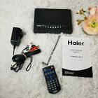 """Haier HLT71 7"""" Digital LCD TV with remote,  power cords, and owners manual"""