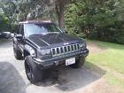 1994 Jeep Grand Cherokee Laredo Sport Utility 4-Door 1994 JEEP GRAND CHEROKEE 4.0L 6CYL FULL TIME 4WD KILLER AUDIO LIFT KIT BIG TIRES