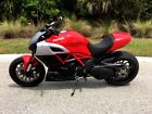 2011 Ducati Sport Touring  2011 Ducati Diavel with less than 1,980 miles