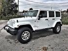 2014 Jeep Wrangler  2014 White Jeep Wrangler Sahara Unlimited